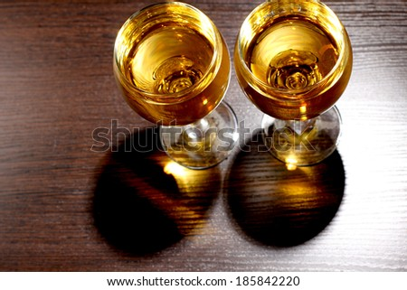 Luxury old whiskey glass on wood background - stock photo