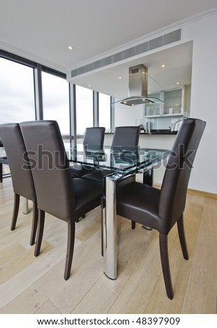 luxury open plan kitchen with dining table - stock photo