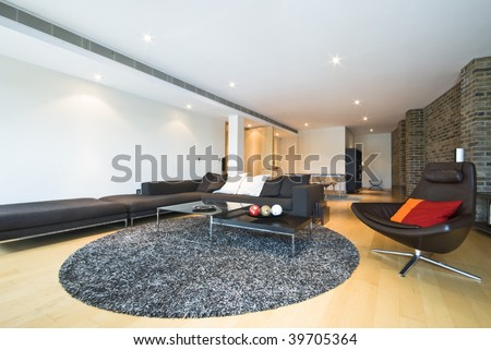 luxury open plan living area with designer furniture - stock photo