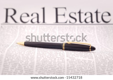 luxury pen on real estate document - stock photo