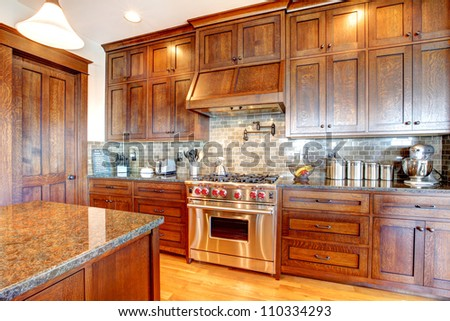 Luxury pine wood beautiful custom kitchen interior design with island and granite.
