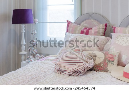 luxury pink color scheme bedroom with lamp at home - stock photo