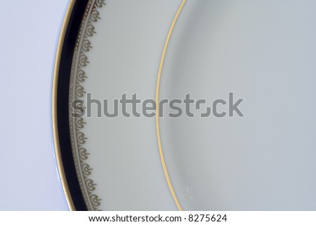 luxury plate from a fancy service (with copy space) - stock photo
