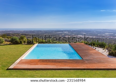 Luxury pool on a background of beautiful scenery. Sea View. - stock photo