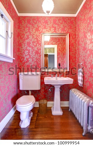Luxury red and gold small bathroom with silver radiator. - stock photo