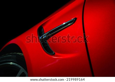 Luxury red car details view, elegant and beautiful - stock photo