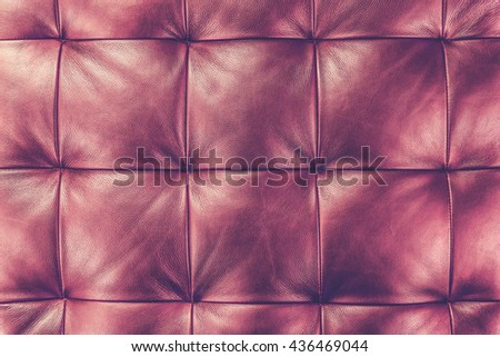 Luxury red leather close-up background (Vintage filter effect used) - stock photo