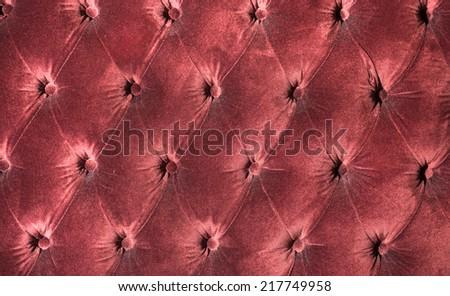 Luxury red velvet cushion close-up background  - stock photo
