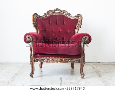 Luxury red vintage style armchair in a vintage room