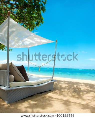luxury relax chair on a beautiful tropical beach. blue sky and green plants - stock photo