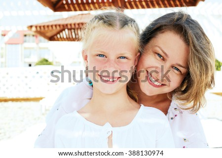 Luxury resort happy family relaxing . Mother and daughter lying down on deckchair of beach resort . Summer vacation idea. - stock photo