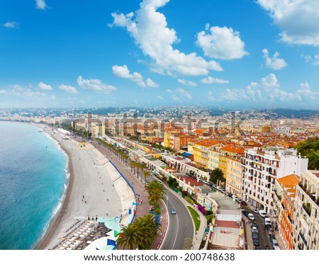 Luxury resort of French Riviera, main street of Nice city in France with beach, shops and palms on sunny summer day