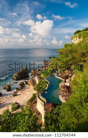 Luxury Resort Salted Pool by the Indian Ocean, Bali, Indonesia - stock photo