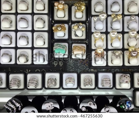 luxury Rings with gems on display in showcase of jewelry store