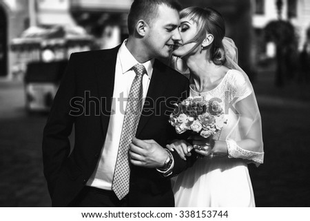 luxury romantic gorgeous tender bride and groom  on the background of old sunny city