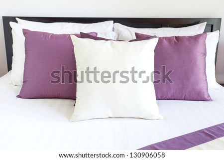 Luxury room setting with bed and pillows - stock photo