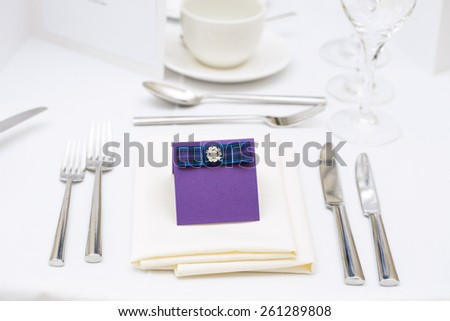 Luxury scottish wedding gala table setting with purple blank personal greeting card - stock photo