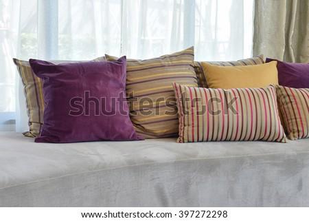 luxury sofa in living room with colorful pillows at home