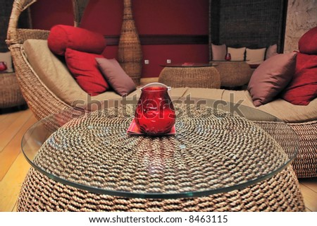 Luxury sofa with table on front and pillows. - stock photo