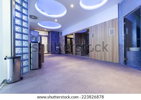 Luxury spa center interior - colorful ambient lights - stock photo