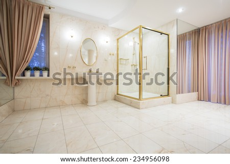 Luxury spacious bathroom interior  in contemporary house - stock photo