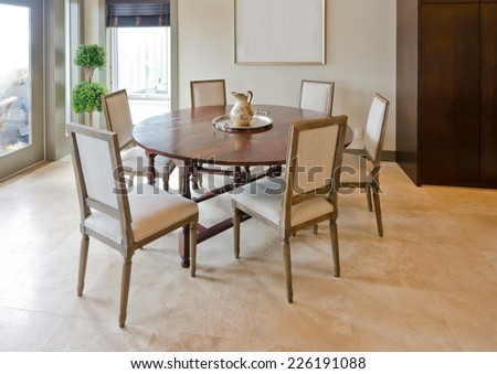 Luxury spacious modern dining room with the table and chairs.  Interior design.
