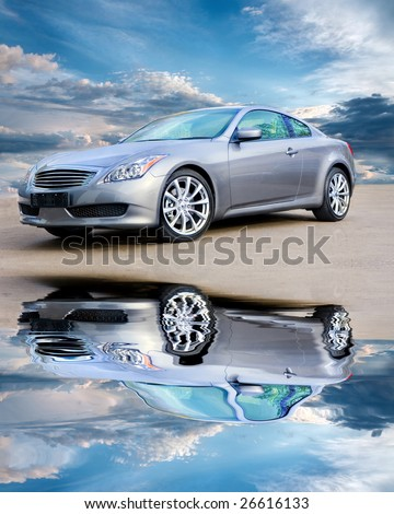 Luxury sports car against bright cloudy sky - stock photo