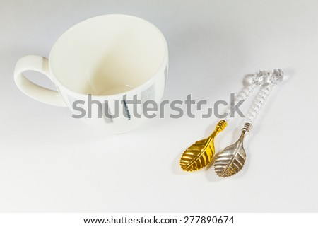 luxury style spoon with tea cup - stock photo