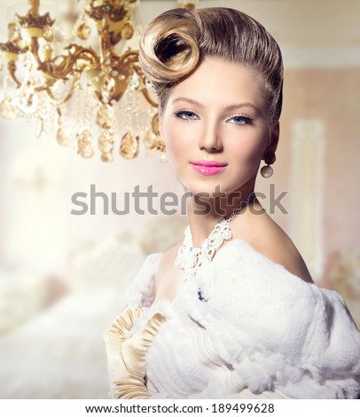 Luxury Styled Beauty Lady Portrait. Retro Woman. Beauty Fashion Vintage Style Girl with Beautiful Hairstyle, makeup, accessories. Golden Silk Gloves, dress, expensive white fur coat, Luxury interior - stock photo