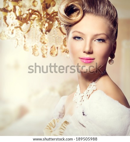 Luxury Styled Beauty Woman Portrait. Retro Girl. Beauty Fashion Vintage Style Lady with Beautiful Hairstyle, makeup, accessories. Golden Silk Gloves, dress, expensive white fur coat, Luxury interior - stock photo