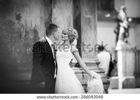 luxury stylish happy ����aucasian blonde bride with groom on the background amazing architecture of lviv