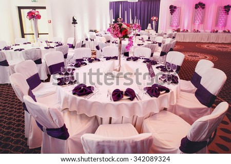 Luxury stylish wedding reception purple decorations expensive hall - stock photo