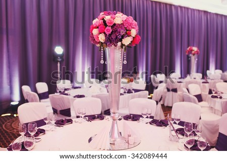 Luxury stylish wedding reception purple decorations expensive hall lights and flowers - stock photo