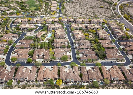 Luxury subdivision with Spanish style and red tile rooftops - stock photo