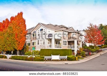 luxury suburban houses in sunny day with blue sky - stock photo