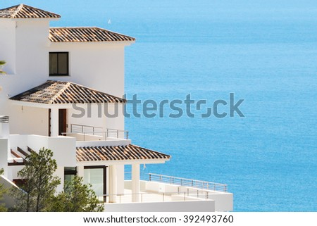 Luxury summer house on the hilly sea coast. Real estate concept - stock photo