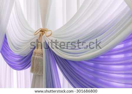 Luxury sweet white and violet curtain and tassel - stock photo