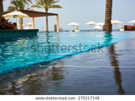 Luxury swimming pool a tropical resort - stock photo