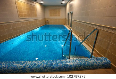 Luxury swimming pool in spa hotel - stock photo