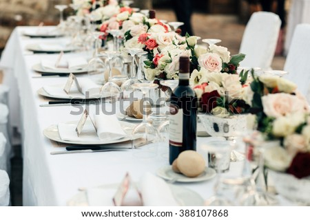 Luxury table with tableware on the wedding table - stock photo