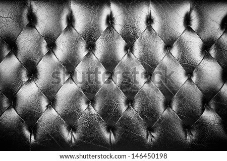 luxury texture, luxury leather button-tufted black chair texture - stock photo