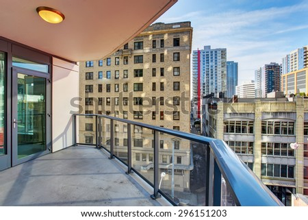 Luxury unfurnished balcony with excellent view of the city. Seattle downtown.
