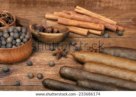 Luxury variety of Cuban cigars are on the wooden table - stock photo