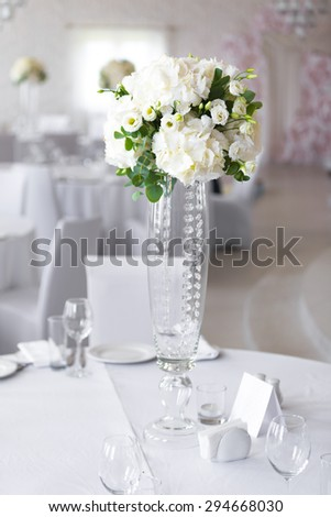 luxury vertical wedding arrangement on the table