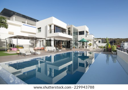 Luxury villa with swimming pool - stock photo