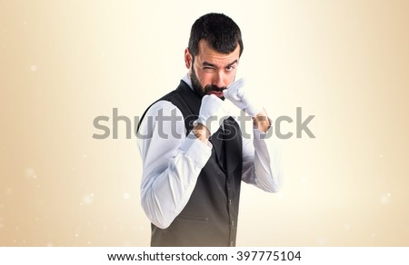 Luxury waiter giving a punch