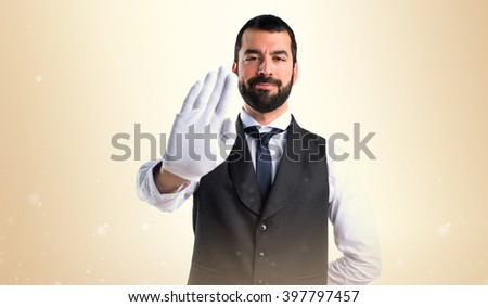 Luxury waiter making stop sign