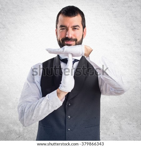 Luxury waiter making time out gesture