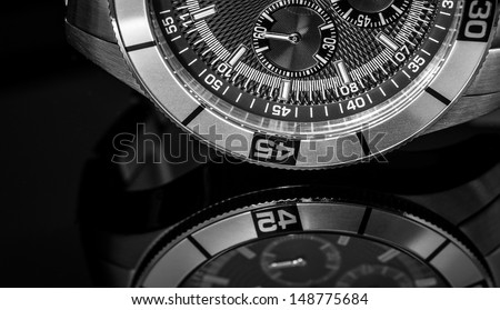 Luxury Watch over reflective surface. Selective focus, shallow depth of field.