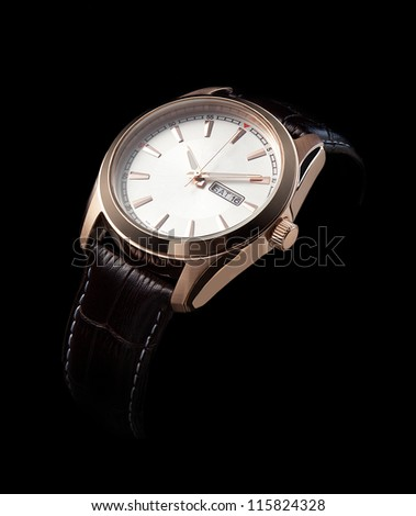 luxury watches with a leather strap on a black background - stock photo